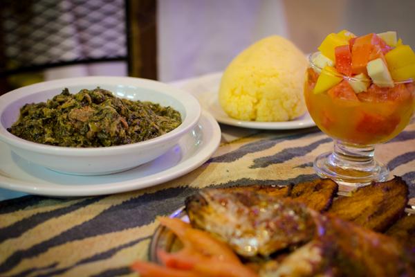 Grilled fish, salsa de acelga, polenta, and fruit salad. (photo - Helena Andell)